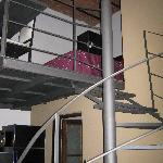 The spiral staircase in the industrial loft. Our bed was up the top.