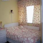 Our twin room - a shot of the double bed - small room but cozy!