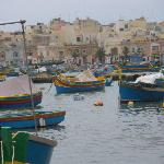Brightly Coloured Luzzu (Fishing boats) at Marsaxlokk harbour