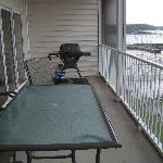 Patio table and grill on screened deck