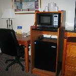 microwave, refrigerator, desk area