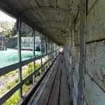 Covered walkway below dam