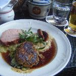 Plate with Veal, Sausage, Meatloaf, Potatoes, Sauerkraut - Delicious