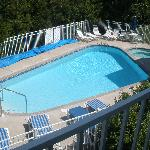 view of pool from upstairs balcony
