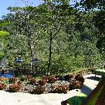 veranda overlooking pool and the river