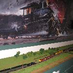 Diorama of the accident below a large painting of the wreck.