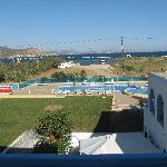 Picture form the hotel room with the pool and the beach/sea.