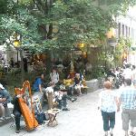 Courtyard, harpist and busy Rue Petit Champlain.