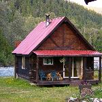 Log cabin comfort by the river