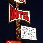 The retro looking motel sign out front.