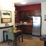 Kitchen has dishwasher, cooktop, microwave, fridge, granite countertops