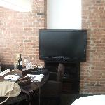 Studio bedroom TV/Brick wall