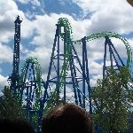 A photo of Aftershock. You get pulled up the left tower, you fly through the cobra roll and loop