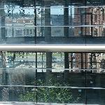 view through the next door glass fronted building to the bullring