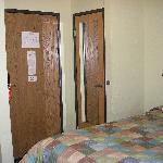 The door--with bed crammed next to it