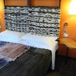 Very comfortable bed with woven headboard