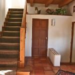 Stairs to the second floor, kitchen on the left (Pinion suite)