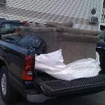 This is the old couch that was replaced on the spot with a brand new one within a half-hour!