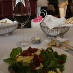 Spinach Salad with warm bacon dressing. Note size of wine pour before first sip.