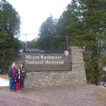 Family pic at the sign leading to Mt Rushmore.