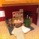 """Survival kit"" and dishtowels on granite counter"