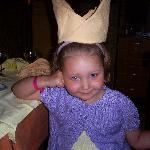 my girl with her napkin crown made by the staff