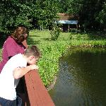 Nephew and sister on the bridge crossing the fishing pond.  A lovely Cracker cottage in the back
