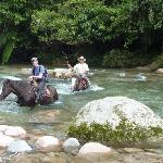 Crossing the river on horse near the lodge