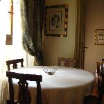 Dining area with a window view of the palazzo vecchio.
