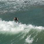 Surfing by the San Clemente pier