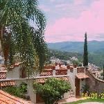 Partial view of house and panora of Taxco