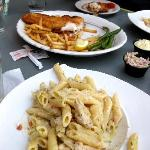 Our main entrees - fish and chips, and chicken pasta alfredo