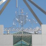 Australian coat of arms on top of Parliament House.