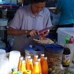 lady making papaya salad @ parap markets