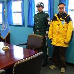 Standing with a South Korea soldier and member of the United Nations Command Security Battalion