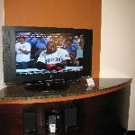 Flat screen TV and iPod station in sitting area