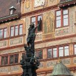 A closer look at the Rathaus and the fountain in front of it.
