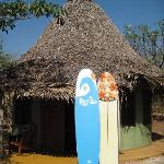 The cabanas with surfboards.