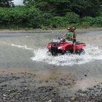 Crossing river on ATV trip