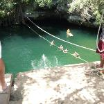 swimming in the Cenote(natural sinkhole-fesh water)