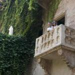 A father and daughter pose on the balcony immortalized by Shakepeare in 'Romeo & Juliet.' There