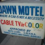 Sign outside motel advertising color TV