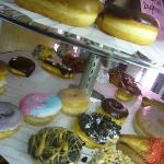 Doughnuts in glass rotating display...I want them all. verdict?? I think they taste like any oth