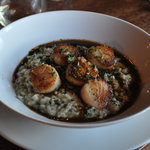 Deliious scallops over risotto.