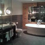 Huge bathroom,  there is also a glass enclosed shower you can't see too much of in the shot