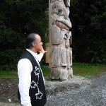 Tour guide giving talk on the story of the totems