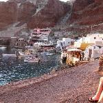 Amoudi Villas is the pink building - top middle of photo, then the 4 restaurants below