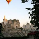 Hot air balloon from the window with castle view