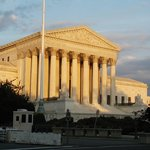 The Supreme Court building as the sun is setting.  Washington DC, July 2009