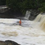 kid trying to swim in the tahquamenon river